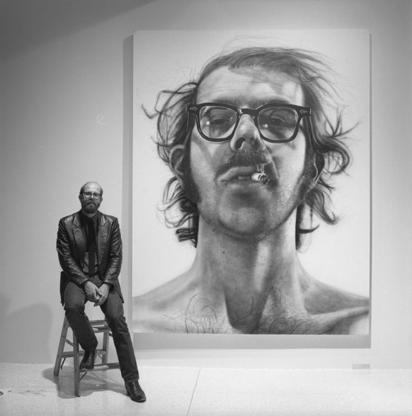 Chuck Close with self portrait